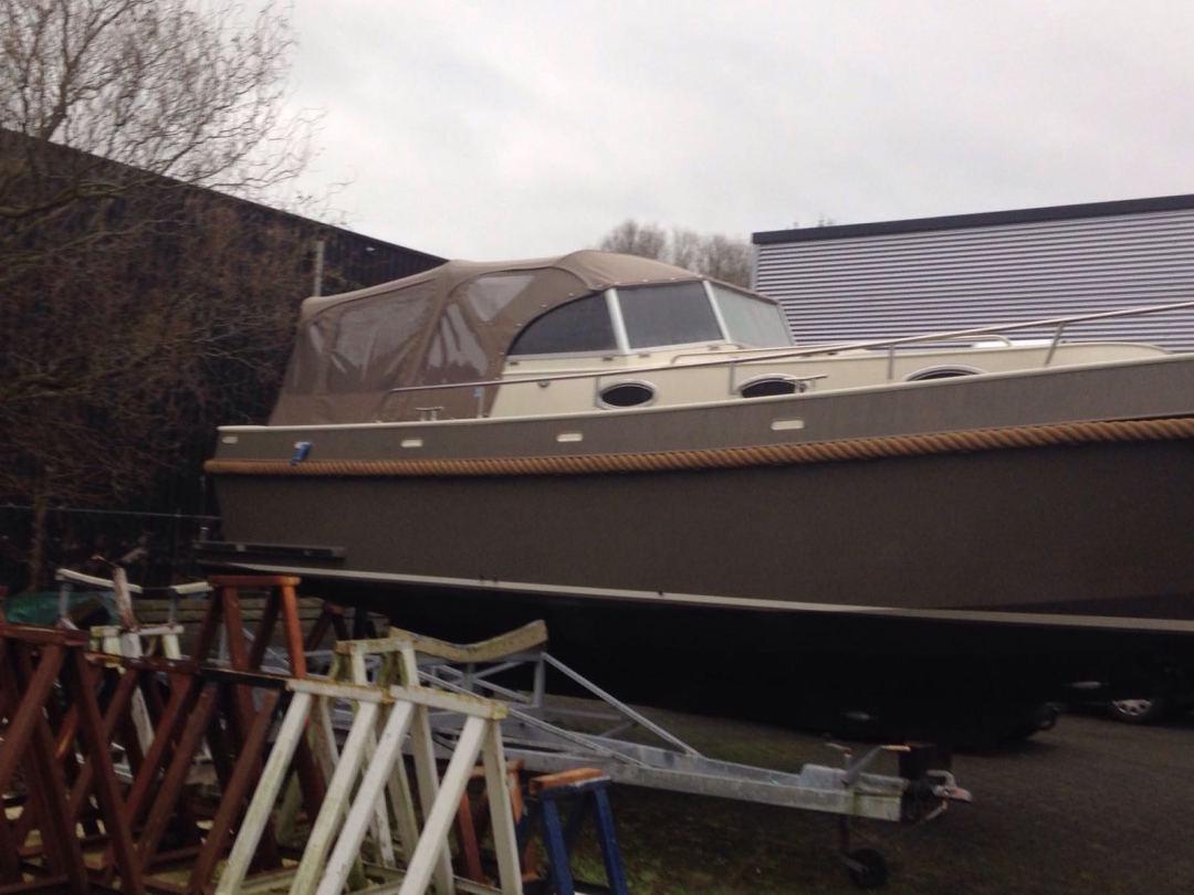 Motorboot cabriotent bruin antaris